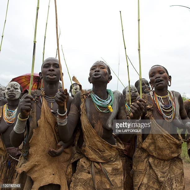 Suri women with stretched lip in Kibbish village Omo valley Ethiopia on July 04 2010 Piercing and lip plates are a strong part of the Suri culture...