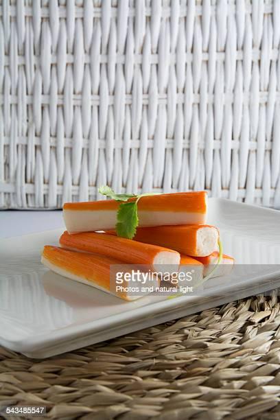 Surimi or crab sticks in a white rectangular plate