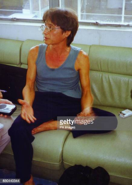 Surin Chanpranet manager of the Aree guesthouse in Chiang Mai Thailand sits in a police station in the city shortly after being brought in for...