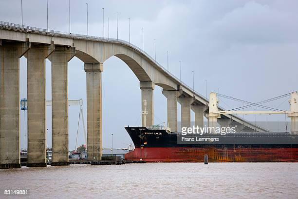Suriname, Cargo boat passing bridge.