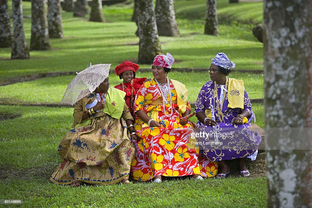 suriname creole women in kotomisi dress stock photo