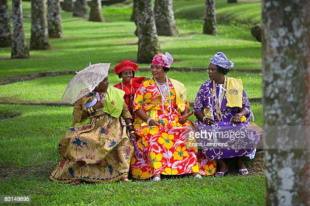 Suriname, Creole women in Kotomisi dress.