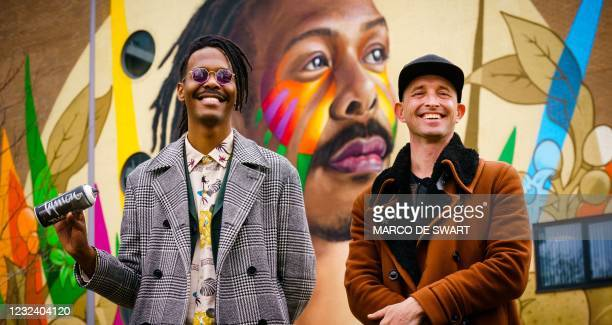 Surinamese singer-songwriter and Eurovision candidate in the run-up to the Eurovision Song Contest Jeangu Macrooy , poses with artist Tymon de Laat,...