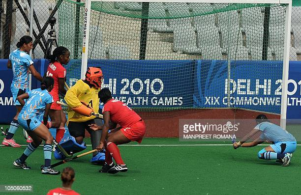 Surinder Kaur of India scores a goal against Trinidad and Tobago during their field hockey match at the Major Dhyan Chand National Stadium during the...