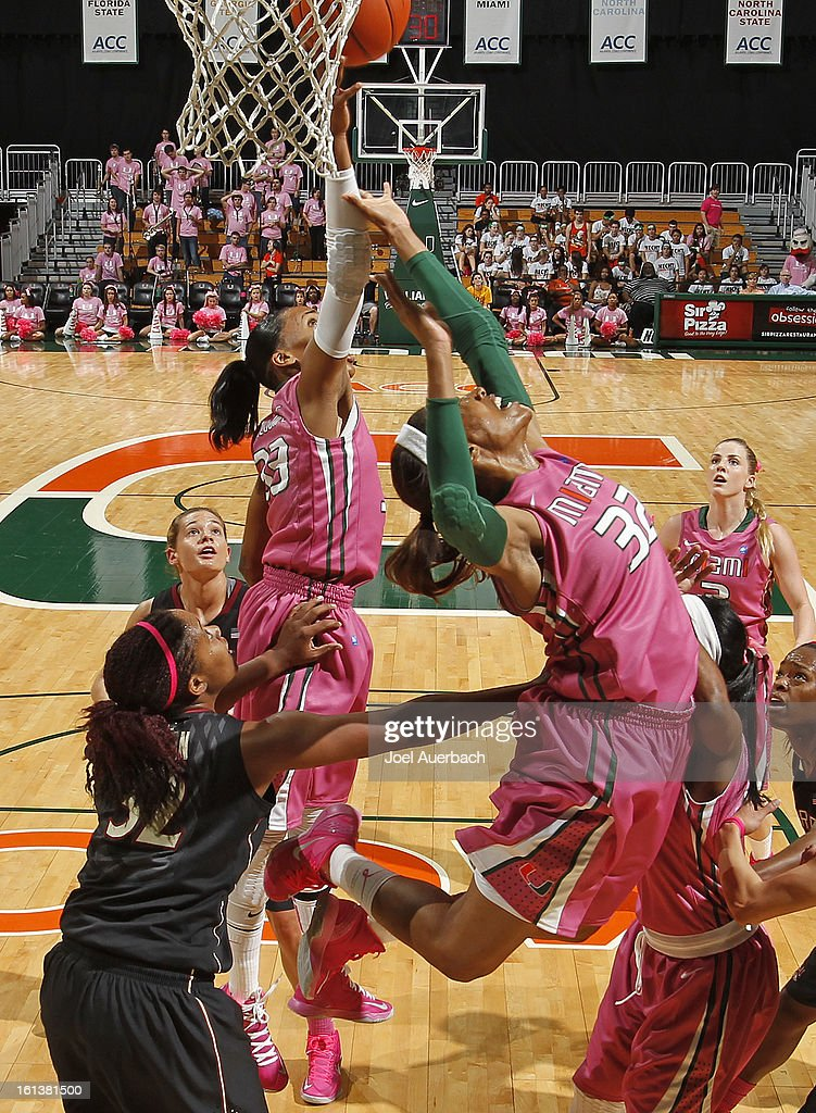 Suriya McGuire #33 and Morgan Stroman #32 of the Miami Hurricanes fight for an offensive rebound during first half action against the Florida State Seminoles on February 10, 2013 at the BankUnited Center in Coral Gables, Florida. The Seminoles defeated the Hurricanes 93-78.