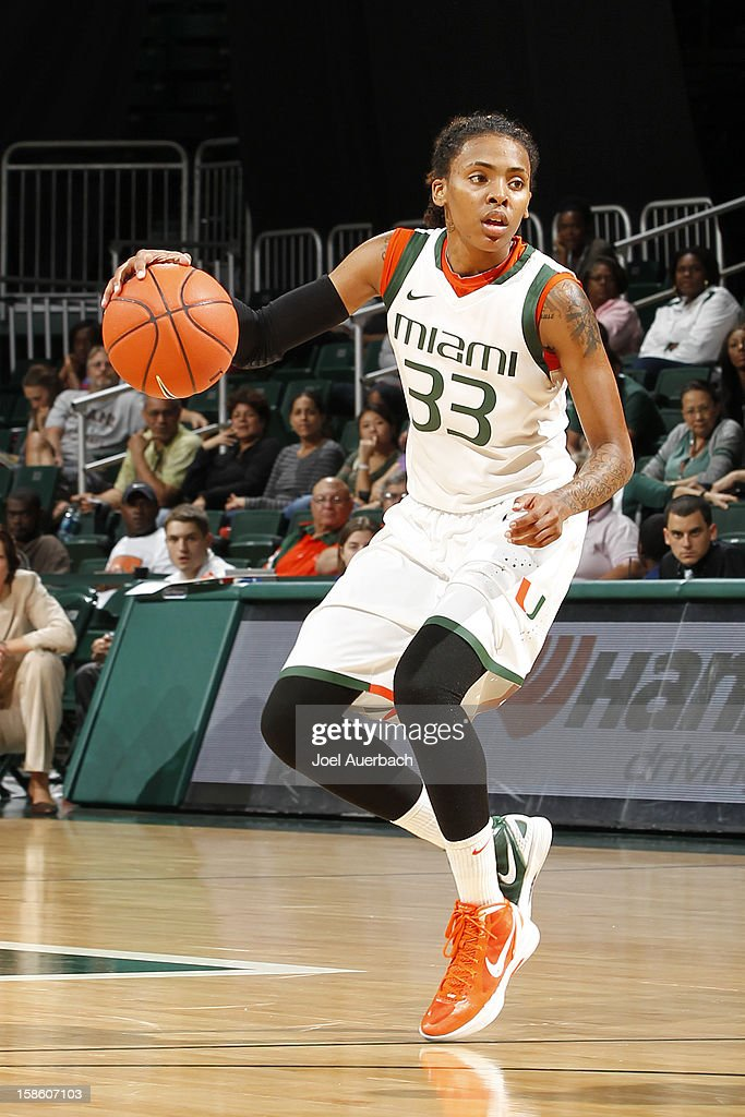Suriya McGuire #33 of the Miami Hurricanes brings the ball up court against the North Carolina State Wolfpack on December 20, 2012 at the BankUnited Center in Coral Gables, Florida. The Hurricanes defeated the Wolfpack 79-53.
