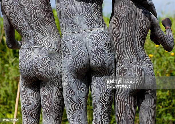 Surma Warriors With Body Paintings in Omo Valley Ethiopia on July 06 2010 One of the main Surma Suri customs is stick fighting This ritual and sport...