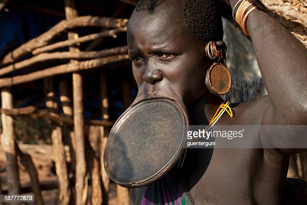 surma woman with a huge lip plate, southern ethiopia - lip plate stock photos and pictures