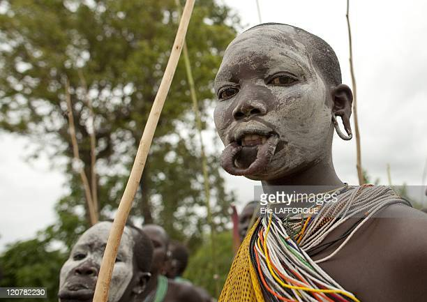 Surma woman with a stretched lip in Kibbish village Omo valley Ethiopia on July 04 2010 Piercing and lip plates are a strong part of the Suri culture...