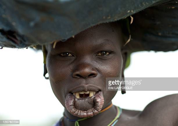 Surma woman with a stretched lip in Turgit village Omo valley Ethiopia on July 04 2010 Piercing and lip plates are a strong part of the Suri culture...