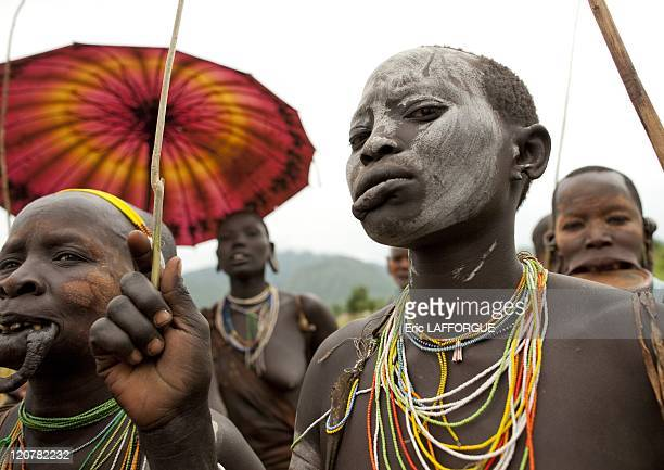Surma women with a stretched lip in Kibbish village Omo valley Ethiopia on July 04 2010 Piercing and lip plates are a strong part of the Suri culture...