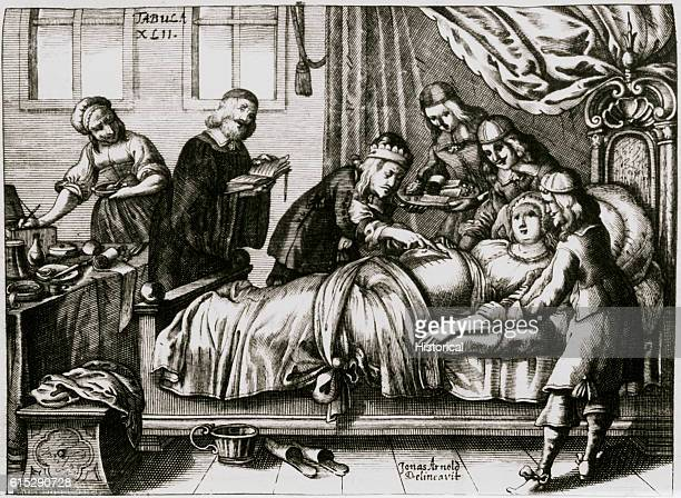 A surpeon and five attendants prepare to perform a caesarean section on a pregnant woman