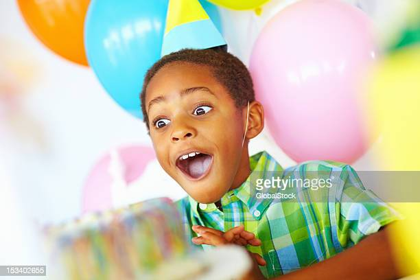 surpised birthday boy - happy birthday stock pictures, royalty-free photos & images