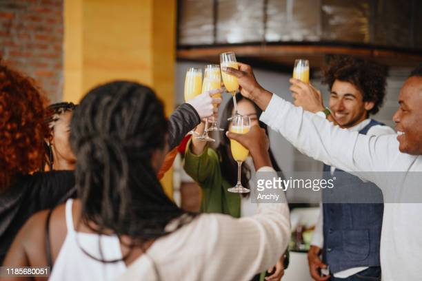 surprise birthday party for one of the roommates - mimosa stock pictures, royalty-free photos & images