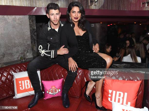 Surprise guest Nick Jonas left and Priyanka Chopra Jonas attend CLUB JBL one of the many events during the 3rd annual JBL Fest an exclusive threeday...