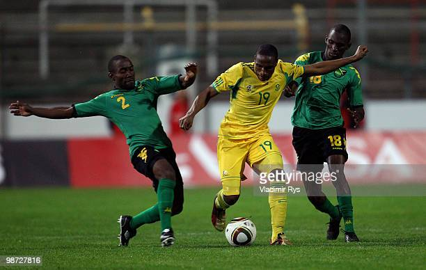 Surprise Moriri of South Africa is tackled by Richard Edwards and Xavian Virgo of Jamaica during the international friendly match between South...
