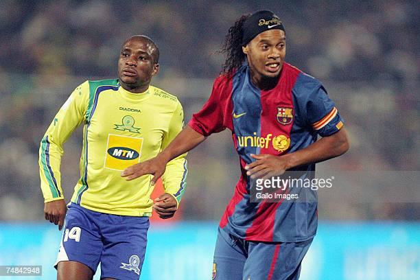 Surprise Moriri of Sundowns and Ronaldinho of FC Barcelona in action during the PSL soccer match between the Sundowns and FC Barcelona at Loftus...