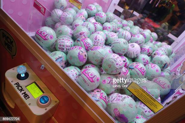 L Surprise toys in a machine during the launch of the LOL Surprise Unboxing Video Booth and LOL Surprise Pets hosted by Hilaria Baldwin at Toys 'R'...