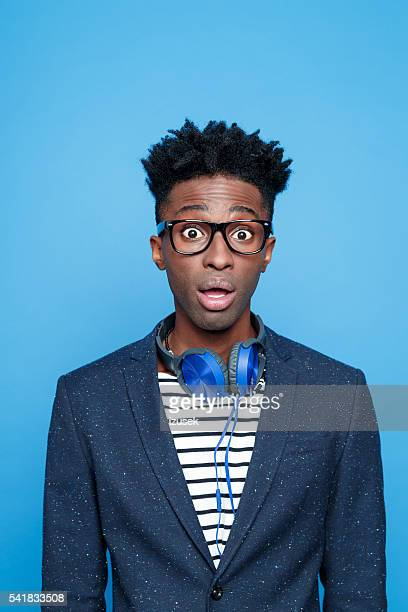 Surprised afro american guy in fashionable outfit