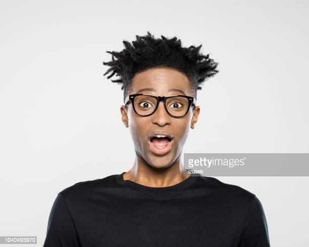 surprised afro american man - izusek stock pictures, royalty-free photos & images