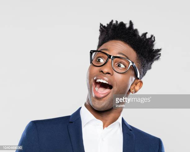 surprised afro american young businessman - awe stock pictures, royalty-free photos & images