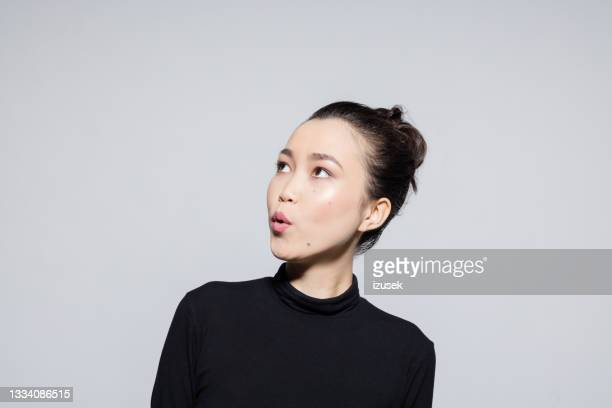 surprised asian young woman - satisfaction stock pictures, royalty-free photos & images