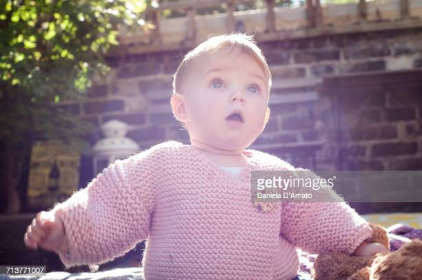 surprised baby girl with open mouth in garden - girls open mouth photos et images de collection