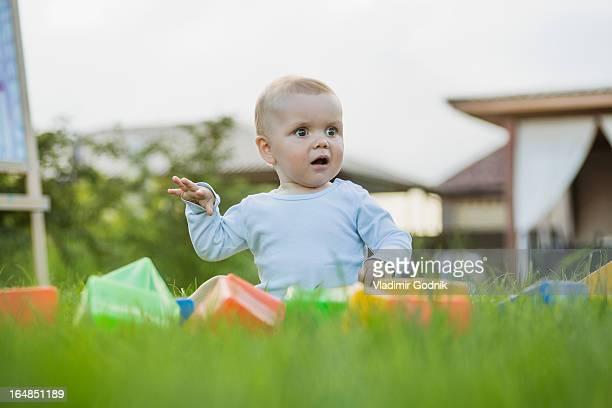 Surprised baby in the garden