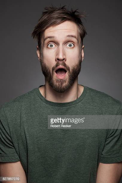 surprised bearded man - surprise stock pictures, royalty-free photos & images