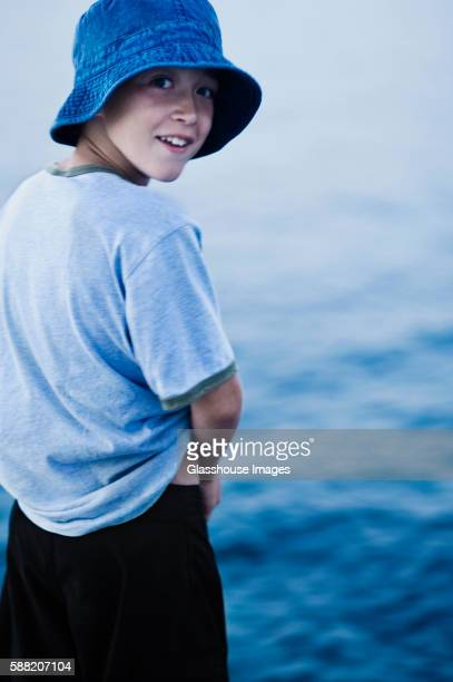 Surprised Boy Looking Over His Shoulder at Sea