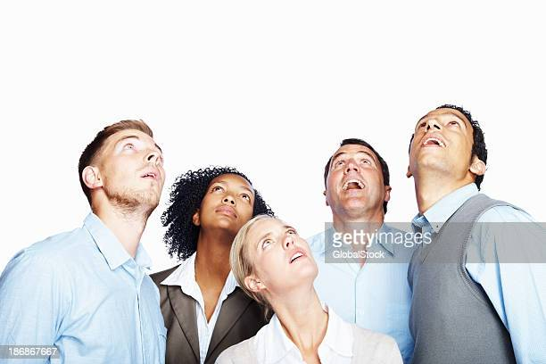 Surprised business people looking up at copy space