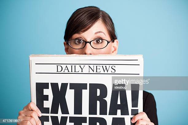 Surprised Business Woman Holding Newspaper with Extra! Headline