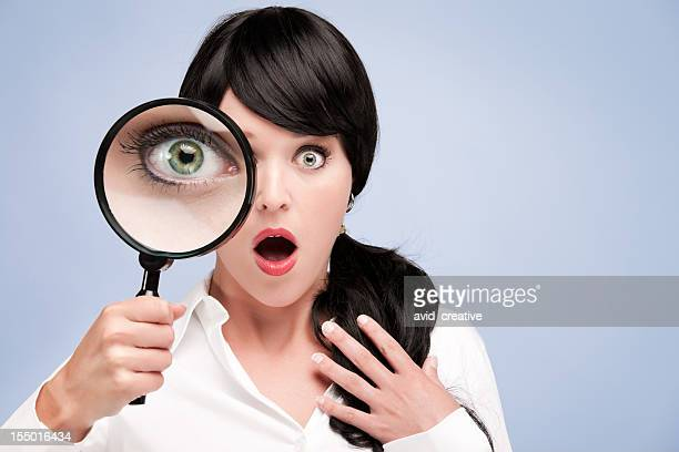 Surprised Businesswoman With Magnifying Glass