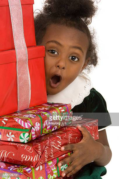 surprised by all of her presents - beautiful ethiopian girls stock photos and pictures