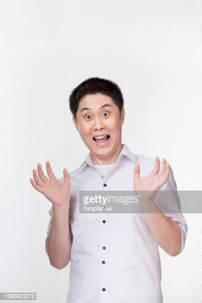 Chinese Man Funny Face Photos And Premium High Res Pictures Getty Images