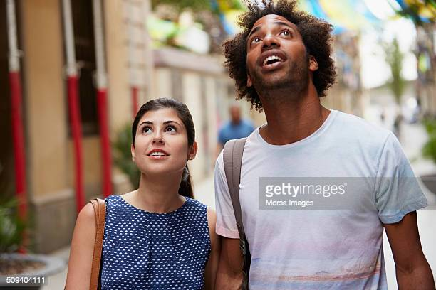 Surprised couple looking up