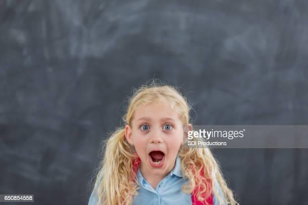 Surprised elementary schoolgirl