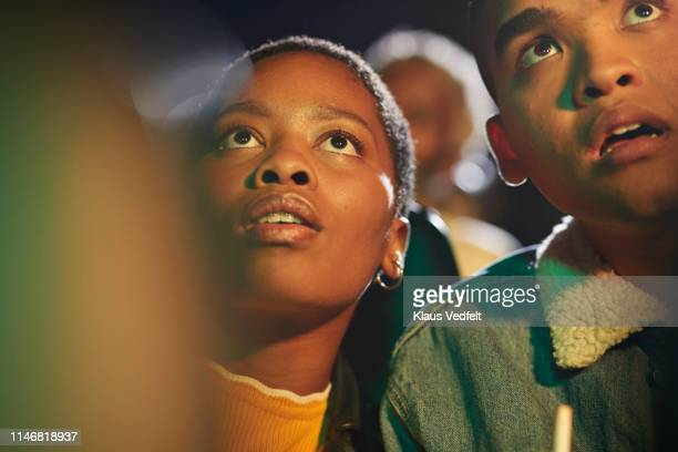 surprised friends watching thriller movie - spectator stock pictures, royalty-free photos & images