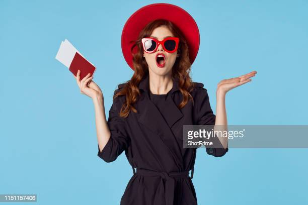 surprised girl with travel tickets and passport - length stock pictures, royalty-free photos & images