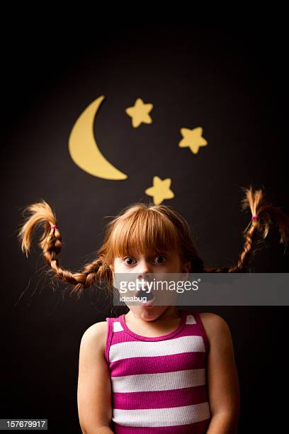 Surprised Girl with Upward Braids Standing Under Moon and Stars