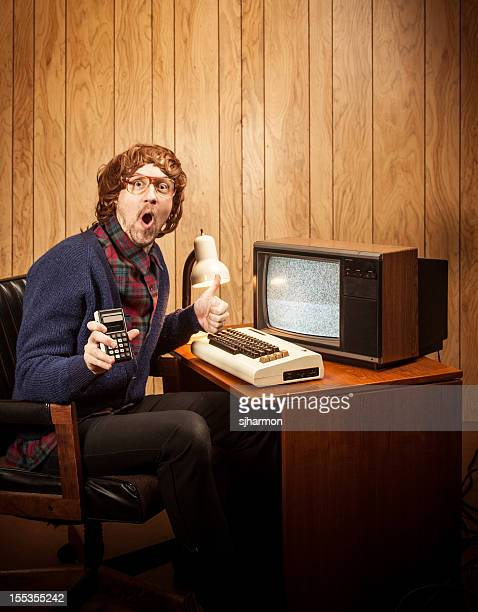 surprised haired geeky nerd man with vintgae computer and calculator - fun calculator stock photos and pictures