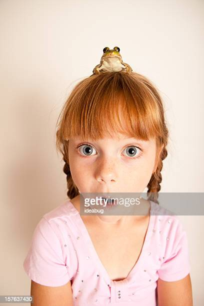 Surprised Little Princess Girl with a Frog on Her Head