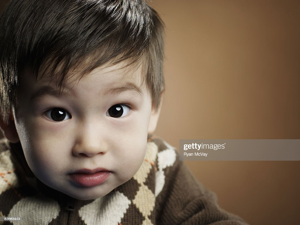 Cute 2 Years Old Little Boy Playing Guitar High-Res Stock