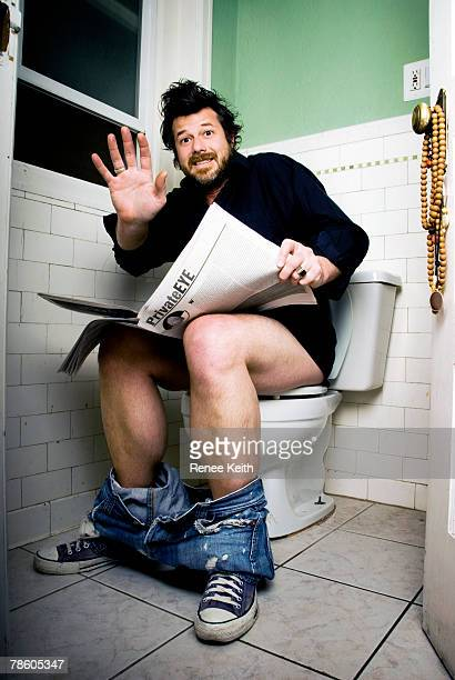 surprised man caught in the bathroom. - men taking a dump stock photos and pictures