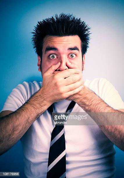 Surprised Man Covering Mouth with Hands