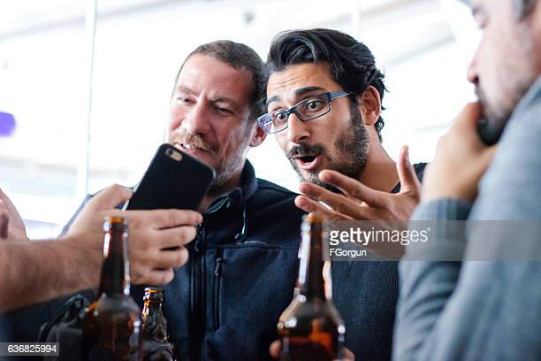 Surprised man watching media in a smart phone