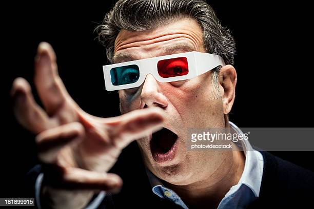 surprised man with 3d stereo glasses - blue film video stock photos and pictures