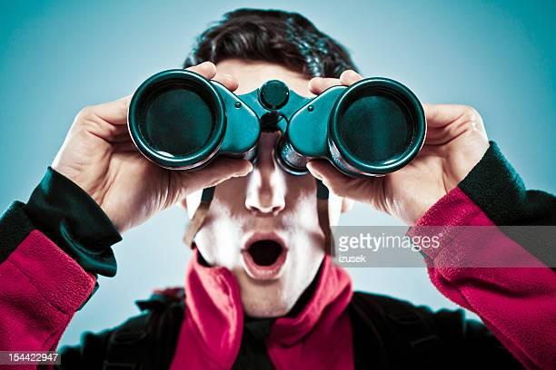 Surprised man with binoculars