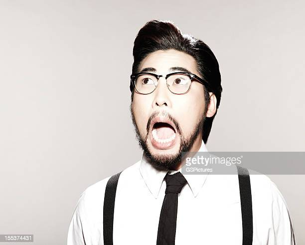 Surprised Man With Suspenders, Tie, and Glasses
