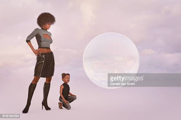 Surprised mother and daughter watching floating sphere
